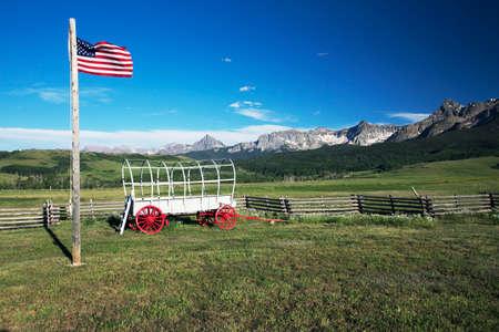 covered wagon: US Flag and covered wagon, Hastings Mesa, near Ridgway, Colorado, USA