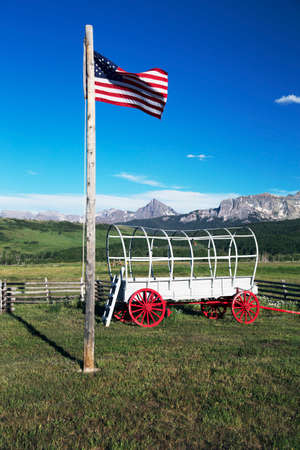 wagon: US Flag and covered wagon, Hastings Mesa, near Ridgway, Colorado, USA