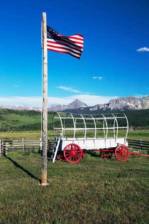 US Flag and covered wagon, Hastings Mesa, near Ridgway, Colorado, USA