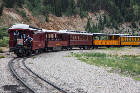narrow gauge: Three Brakemen on Durango and Silverton Narrow Gauge Railroad Steam Engine Train, Silverton, Colorado, USA Editorial