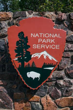 western script: National Park Service entry sign