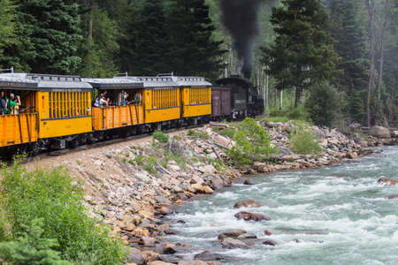 narrow gauge railroad: The Durango and Silverton Narrow Gauge Railroad Steam Engine travels along Animas River, Colorado, USA