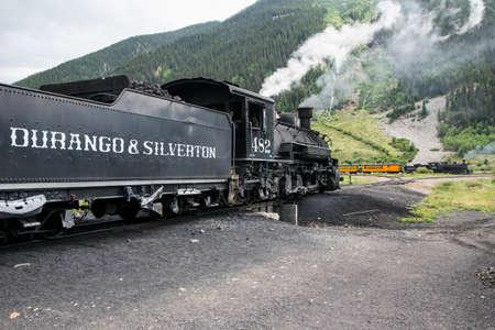 narrow gauge: Two trains, Durango and Silverton Narrow Gauge Railroad featuring Steam Engine, Silverton, Colorado, USA Editorial