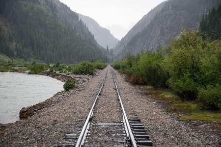 narrow gauge railroad: Raid Road tracks towards mountains and Animas River, Durango and Silverton Narrow Gauge Railroad, Silverton, Colorado, USA