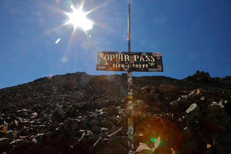 ouray: Sign reads Ophir Mountain pass at 11,789 feet elevation in San Juan Mountains In Autumn Colorado, near Telluride, Ouray and Ridgway in San Miguel County