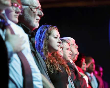 pledge of allegiance: LAS VEGAS, NV - OCTOBER 13 2015: (L-R) Democratic presidential debate shows audience during opening pledge of allegiance.
