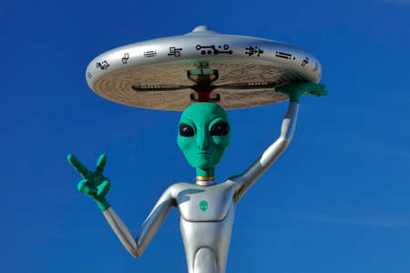 extra terrestrial: ET with flying saucer on his head off Interstate 15, Baker, CA. Extra Terrestrial highway, California