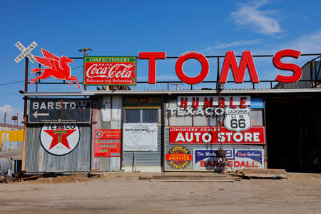 americana: Vintage collection of Americana gas station road signs outside Barstow on historic Route 58, CA Editorial