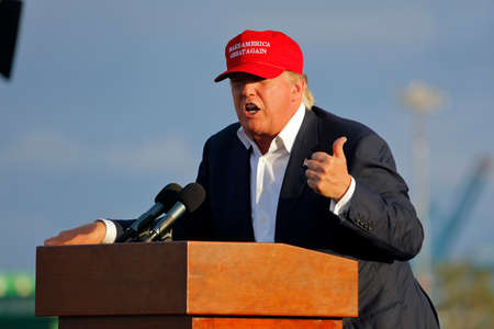 a battleship: SAN PEDRO, CA - SEPTEMBER 15, 2015: Donald Trump, 2016 Republican presidential candidate, speaks during a rally aboard the Battleship USS Iowa in San Pedro, Los Angeles, California while wearing a red baseball hat that says campaign slogan Make America G Editorial