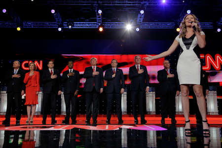 anthem: LAS VEGAS - DECEMBER 15: Ayla Brown sings national anthem at Republican as presidential candidates hold hand over heart at presidential debate at Venetian, we see (L to R) John Kasich, Carly Fiorina, Sen. Marco Rubio, Ben Carson, Donald Trump, Sen. Ted Cr