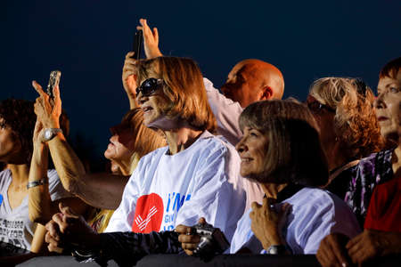admirers: LAS VEGAS, NV - OCTOBER 14, 2015: Audience memebers and supporters smile at Hillary Clinton, former U.S. secretary of state and 2016 Democratic presidential candidate, at Hillary for America Nevada Rally, Springs Preserve Amphitheater