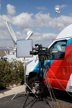 REAGAN PRESIDENTIAL LIBRARY, SIMI VALLEY, LA, CA - SEPTEMBER 16, 2015,video camera with reflector and satellite dishes with TV broadcast vans for Republican Presidential Debate.