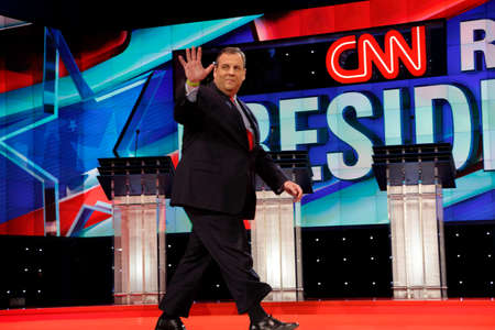 LAS VEGAS, NV, Dec 15, 2015, NJ Gov. Chris Christie a 2016 presidential candidate, waves on stage at the start of the Republican presidential candidate debate at The Venetian.