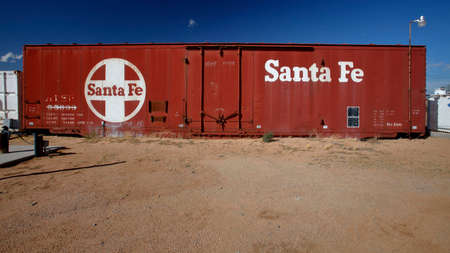 goods train: Empty Santa Fe Box car on desert house lot outside Barstow, CA