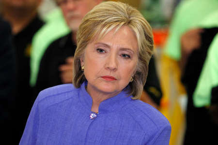 allied: HENDERSON, NV - OCTOBER 14, 2015: Democratic U.S. presidential candidate & former Secretary of State Hillary Clinton listens at International Union of Painters and Allied Trades (IUPAT) training center