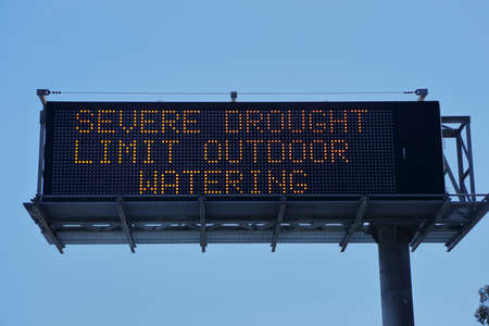 urging: SOUTHERN CALIFORNIA, FEBRUARY 2016 - Signs warning residents of an extreme drought and urging lower water consumption and no outdoor landscape watering