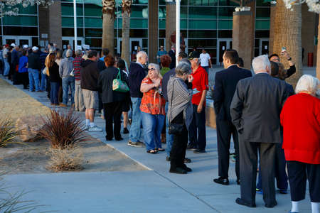 primaries: LAS VEGAS, FEB 23: Caucus goers and voters wait in line to enter a caucus location in Las Vegas, Nevada, U.S., on Tuesday, Feb. 23, 2017