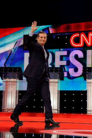 ted: LAS VEGAS, NV, Dec 15, 2015, Senator Ted Cruz, a Republican from Texas and 2016 presidential candidate, walks and waves on stage at the start of the Republican presidential candidate debate at The Venetian.
