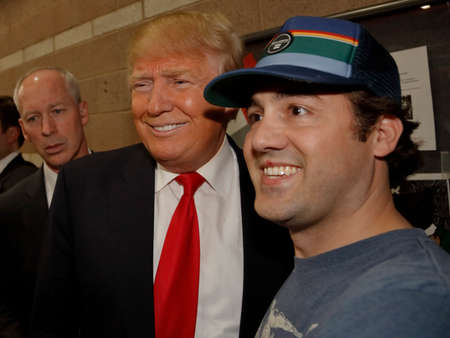 donald: LAS VEGAS, NV - FEBRUARY 23: Presidential candidate for the Republican 2016 Presidential Primary Campaign, Donald J. Trump shakes hands and poses for selfies with voters and supporters at Nevada caucus, Palos High School, Las Vegas.