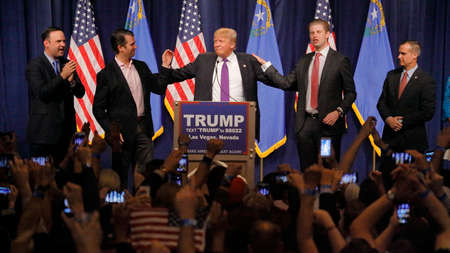 election night: LAS VEGAS, NV - FEBRUARY 23: Donald Trump is flanked by sons Eric (Right) and Donald Jr. (Left) during Mr. Trumps victory speech following big win in Nevada caucus, Las Vegas, NV at Treasure Island Casino and Hotel