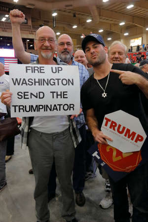 donald: Supporters of Republican presidential candidate Donald Trump holds political sign at the South Point Arena & Casino in Las Vegas, Nevada on February 22, 2016, a day before Nevadas First in the West presidential caucus