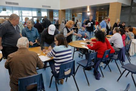 primaries: LAS VEGAS, FEB 23: Caucus goers and voters participate in election caucus at Desert Oasis High School, Las Vegas, NV Editorial