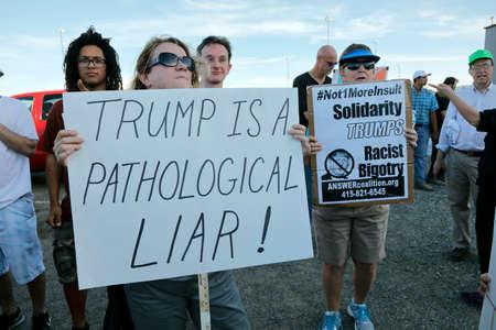protestors: SACRAMENTO, CA - JUNE 01, 2016: protestors stand outside a campaign event to protest presumptive Republican presidential nominee