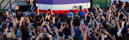 political rally: SANTA MONICA, CA - MAY 23, 2016: Supporters of Democratic presidential candidate Bernie Sanders (D - VT) take pictures at a Presidential rally at Santa Monica High School Football Field in Santa Monica, California.