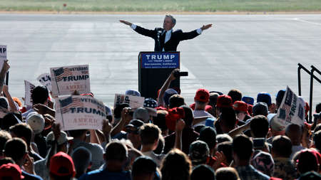 introduces: SACRAMENTO, CA - JUNE 01, 2016: local man introduces Republican Presidential candidate Donald Trump at a campaign rally in airport hanger in Sacramento, California