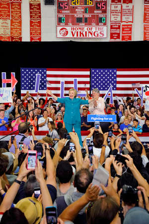 OXNARD, CA - JUNE 04, 2016: Congresswoman Julia Brownley introduces former Secretary of State Hillary Clinton and Democratic Presidential Candidate before she speaks at a Get out the Vote rally at Hueneme High School in Oxnard, California.