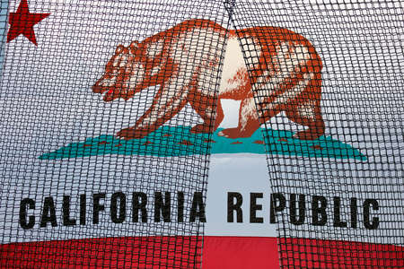 political rally: VENTURA, CA - MAY 26, 2016: State of California State Flag behind netting at Bernie Sanders campaign rally at Ventura College, in preparation for June 7 California Primary Election.