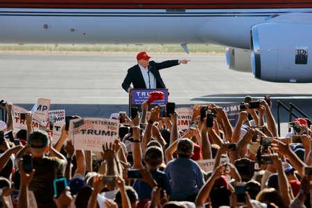 donald: SACRAMENTO, CA - JUNE 01, 2016: Republican Presidential candidate Donald Trump speaks at a campaign rally in airport hanger in Sacramento, California Editorial