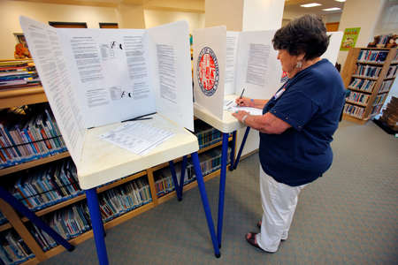 voting booth: VENTURA COUNTY, CA - JUNE 7, 2016 -- Senior female votes at Oak View Polling Station for California primary voting taking place on June 07, 2016 in Ventura County, California.