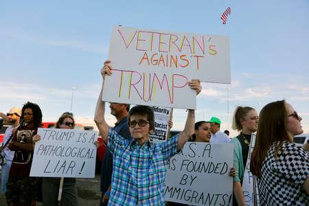 protestors: SACRAMENTO, CA - JUNE 01, 2016: protestors stand outside a campaign event to protest presumptive Republican presidential nominee,