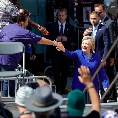 political rally: LOS ANGELES, CA - JUNE 6, 2016 - Democratic presidential candidate Hillary Clinton greets supporters at Get Out The Vote rally in Leimert Park Village Plaza a day before the California Primary