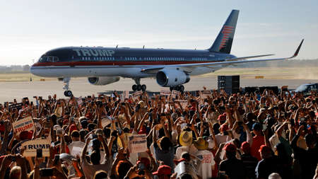 donald: SACRAMENTO, CA - JUNE 01, 2016: Republican Presidential candidate Donald Trump arrives at a campaign rally in his  jet at airport hanger in Sacramento, California Editorial