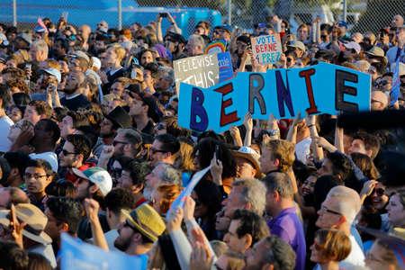 monica: SANTA MONICA, CA - MAY 23, 2016: Supporters of US Democratic presidential candidate Bernie Sanders (D - VT) at a Presidential rally at Santa Monica High School Football Field in Santa Monica, California.