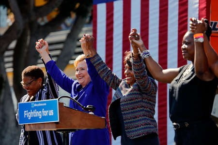 political rally: LOS ANGELES, CA - JUNE 6, 2016 - Democratic presidential candidate Hillary Clinton,  joins hands with U.S. Representative Karen Bass, left, and Congresswoman Maxine Waters and Sybrina Fulton (mother of Trayvon Martin)campaign rally in Leimert Park Village