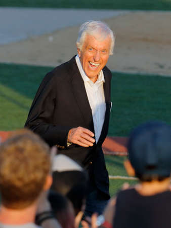 introduces: SANTA MONICA, CA - MAY 23, 2016: TV Actor & Comedian Dick Van Dyke introduces US Democratic presidential candidate Bernie Sanders (D - VT) at a Presidential rally at Santa Monica High School Football Field in Santa Monica, California. Editorial