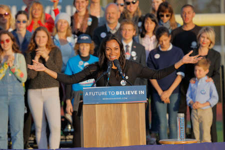 introduces: SANTA MONICA, CA - MAY 23, 2016: Actress Rosario Dawson introduces US Democratic presidential candidate Bernie Sanders (D - VT) at a Presidential rally at Santa Monica High School Football Field in Santa Monica, California. Editorial