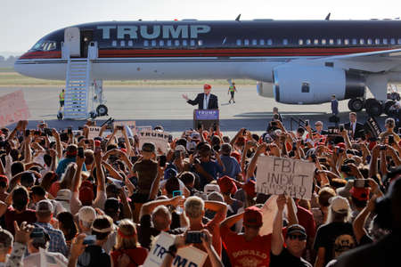 speaks: SACRAMENTO, CA - JUNE 01, 2016: Republican Presidential candidate Donald Trump speaks at a campaign rally in airport hanger in Sacramento, California Editorial