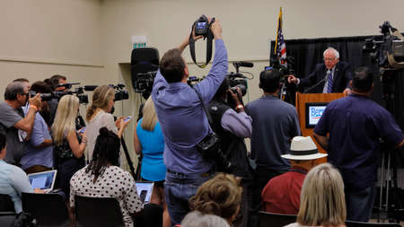 political and social issues: MODESTO, CA- JUNE 02, 2016: Presidential candidate, Bernie Sanders framed by TV cameras hosts a press conference prior to a rally at Modesto Centre Plaza in Modesto, CA.