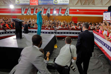 scamper: OXNARD, CA - JUNE 04, 2016: photographers scamper to photograph Hillary Clinton and Democratic Presidential Candidate at a Get out the vote rally at Hueneme High School in Oxnard, California.