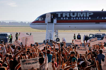 political rally: SACRAMENTO, CA - JUNE 01, 2016: Republican Presidential candidate Donald Trump arrives at a campaign rally in his  jet at airport hanger in Sacramento, California Editorial