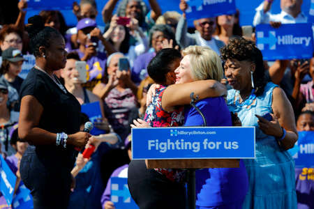 political rally: LOS ANGELES, CA - JUNE 6, 2016 - Democratic presidential candidate Hillary Clinton, shares stage with Sybrina Fulton (mother of Trayvon Martin), Gwen Carr (mother of Eric Garner) and Wanda Johnson (mother of Oscar Grant) at a Get Out The Vote rally in Lei Editorial