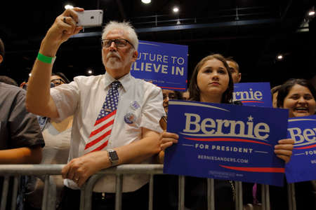 political rally: MODESTO, CA- JUNE 02, 2016: Supporters video Bernie Sanders speaking at a Democrat Presidential Candiate at a rally at Modesto Centre Plaza, Modesto, CA