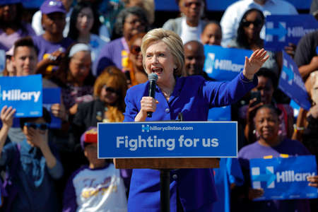 political rally: LOS ANGELES, CA - JUNE 6, 2016 - Democratic presidential candidate Hillary Clinton Speaks at a Get Out The Vote rally in Leimert Park Village Plaza a day before the California Primary Editorial