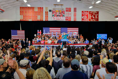 political rally: OXNARD, CA - JUNE 04, 2016: former Secretary of State Hillary Clinton and Democratic Presidential Candidate speaks at a Get out the vote rally at Hueneme High School in Oxnard, California.