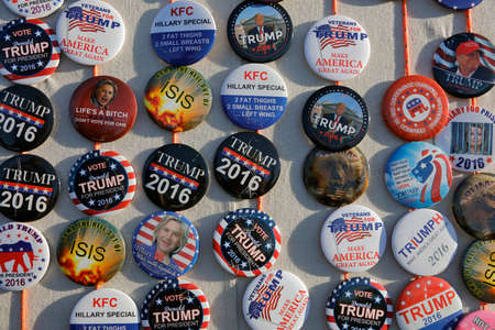 political rally: SACRAMENTO, CA - JUNE 01, 2016: Political Buttons supporting Republican Presidential candidate Donald Trump are seen for sale at a campaign rally
