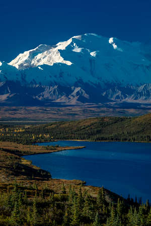 Mount Denali and Wonder Lake, previously known as Mount McKinley, the highest mountain peak in North America, at 20, 310 feet above sea level. Alaska Mountain Range, Denali National Park and Preserve.